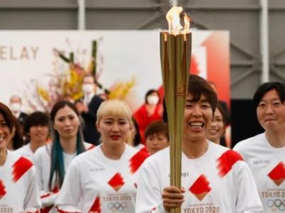 Tokyo Olympic torch begins long journey across Japan
